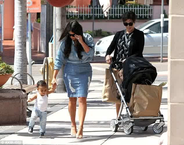First Steps: North West Walks Alongside Mom Kim K In Matching Ripped Denim Ensembles