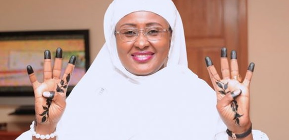 Aisha Buhari Gets 4+4 Tattoo In Support Of Buhari's Re-Election